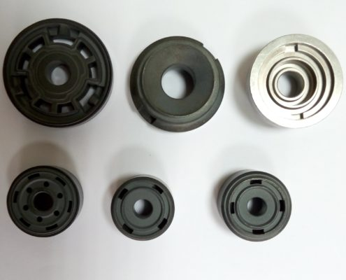 Sintered pistons for shock absorbers