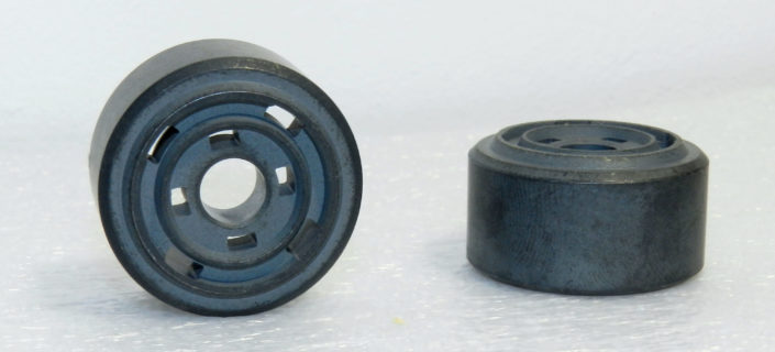 Sintered components of shock absorbers